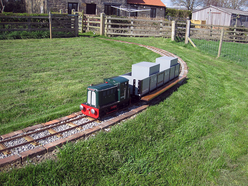 6.	The train paused on the long embankment in the field side of the loop.