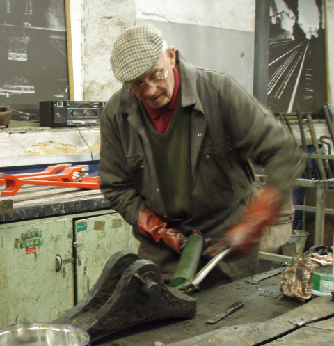 Nev Barlow testing the grease path on a brake pin - Nigel Hall