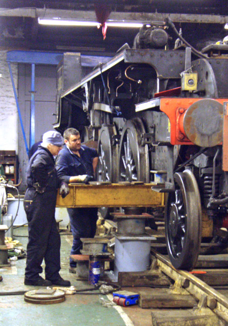 The front of locomotive is lifted on an I beam. Steve Hyman and Chris Atkinson of Durham Lifting await instructions - Nigel Hall