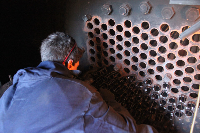 Assistant Jamie securing tubes in the J72s smokebox using nails - Neal Woods