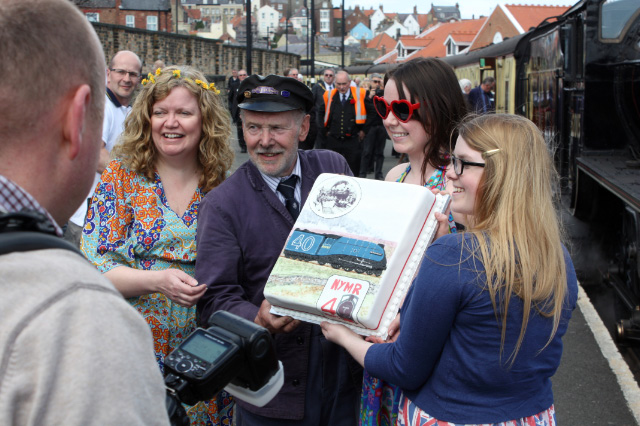 Driver Terry Newman at Whitby surrounded by his admirers with the 40th anniversary cake - Nick Carter