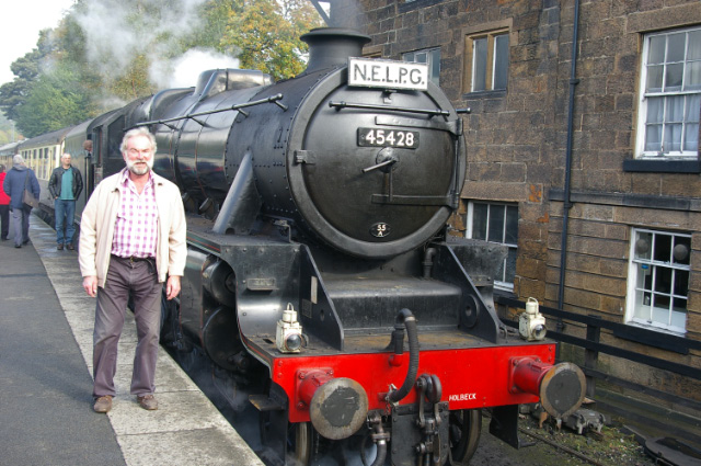 Founder member Peter Proud stands by Black Five 45428 'Eric Treacy' at Grosmont Station, before it departs with the NELPG Members Diner on 19 October 2013 - Chris Lawson