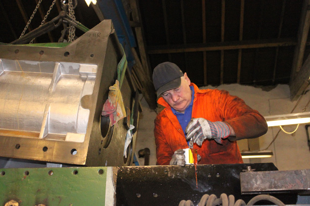 Steve Gibson prepares to coat frames with jointing compound - Neal Woods