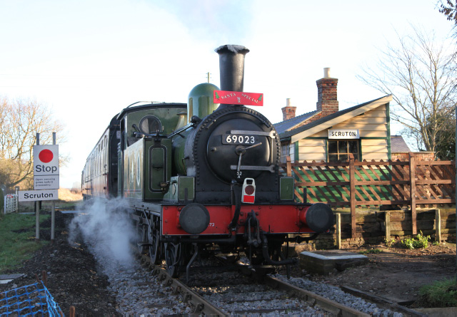 Joem passes through Scruton rebuilt station on the tail of the 10.30 from Leeming Bar Santa Special - Maurice Burns
