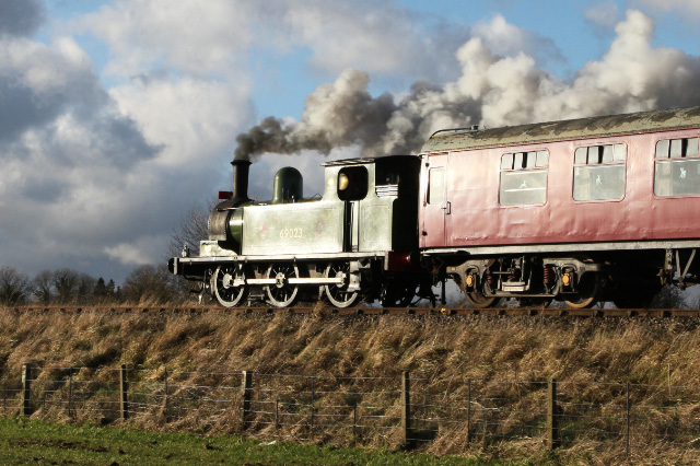 Joem catches the glint on the 12.30 Leeming Bar Santa Special approaching Leeming - Maurice Burns