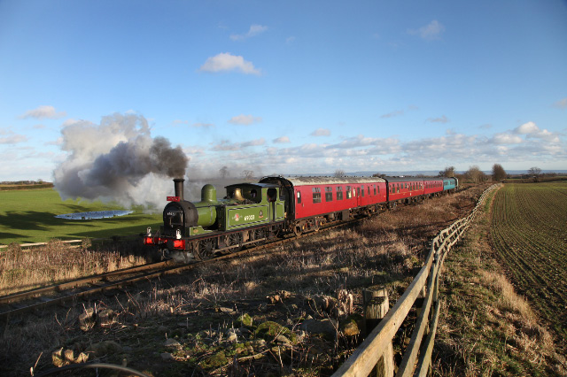 Joem climbing from Station Road, Crakehall towards Newton le Willows on the 12.30 Santa Special - Maurice Burns