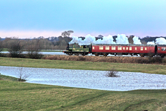 A close view as Joem departs its last train of 2013 that had stopped just before the River Swale bridge due to extreme high water levels. The flooded fields on both side of the tracks can be seen - Maurice Burns
