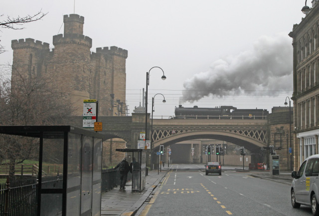 The Wansbeck Railtour heads out of Newcastle hauled by B1 61264 to Morpeth  passing the Castle Keep and the road to Robert Stephenson's High Level bridge -  Maurice Burns