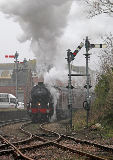 The K1 heading north passing the signals of Bedlington North box heads for the coast of North Blyth The chairman can be seen photographing his predecessor from the fireman's window -  Maurice Burns