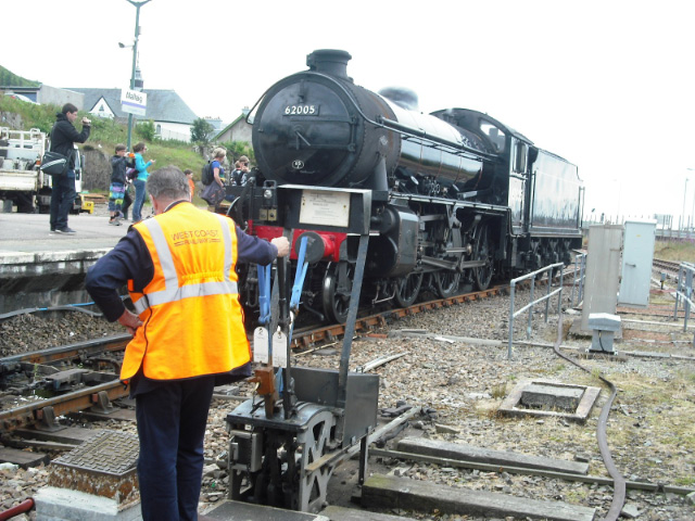 John Hunt operates the ground frame to allow 62005 to run round the train at Mallaig - John Midcalf