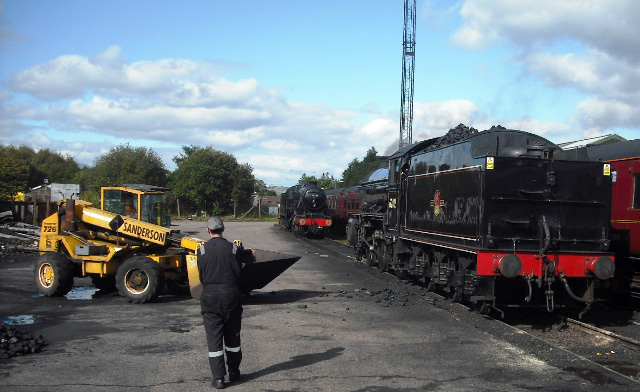 Andy Heald and Nigel Bill loading coal at Foprt William - John Midcalf