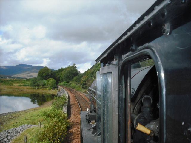 Leaving Banavie, the Jacobite passses the wall by Loch Eil which features in the classic reflection shot - John Midcalf