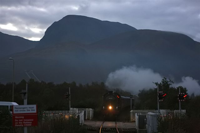 In the dawn light with Ben Nevis in the background, the K1 arrives at Banavie - Dave Whitfield