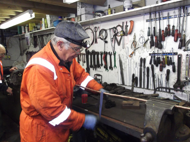 Mike Oliver cleaning cab pipework in the Deviation Shed workshop. Wed 25/3/15 - Darrin Crone