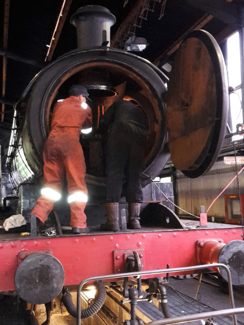 Andy Lowes and Paul Hutchinson fitting the new spark arrestor support to the blast pipe - Nigel Hall