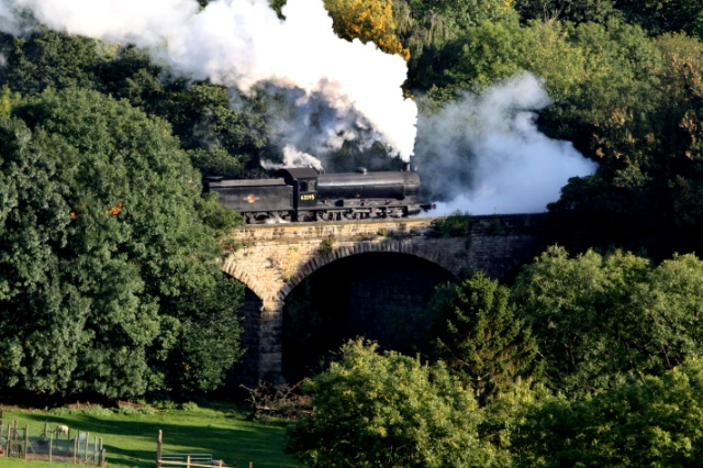Q6 on the 16.00 Grosmont to Pickering suffering badly with priming as it crosses the Murk Esk - Maurice Burns