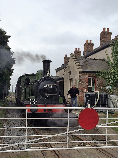 Examining the loco at Finghall Lane - John Midcalf