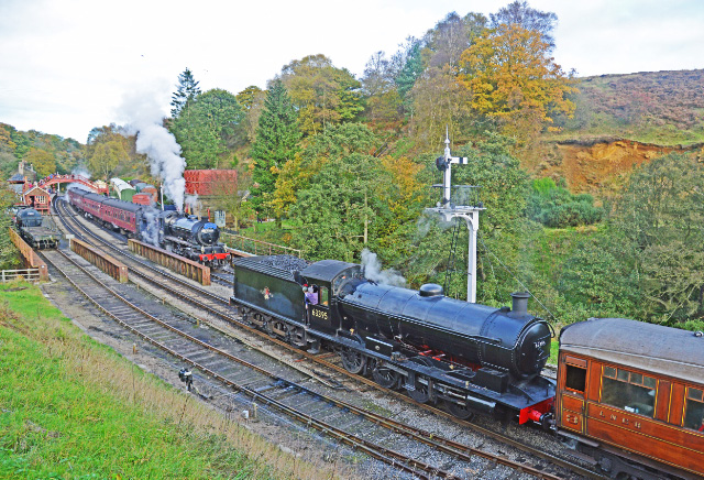 Q6 with the 11.00 ex Pickering passes the K1 with the 11.30 ex Grosmont at Goathland - John Hunt