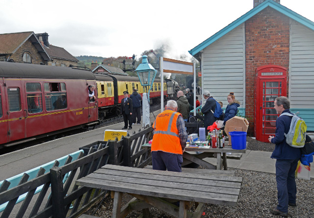 John Midcalf with tombola machine on Grosmont station platform - John Hunt