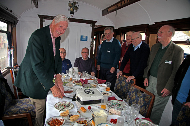 George Nissen cuts the 50th cake in the GN saloon - Maurice Burns