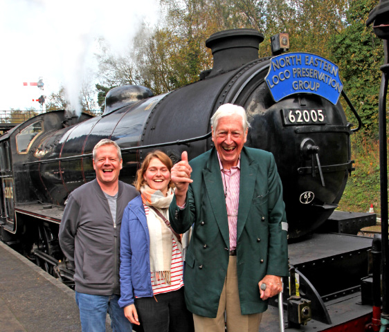 "George Nissen (right) after a ride behind ""his"" K1 poses with his son Ed Nissen and grand daughter Emily Simons at Grosmont.  The ""thumbs up"" he said was to signify he certainly made the right decision with the other three owners to donate the K1 to NELPG! - Maurice Burns"