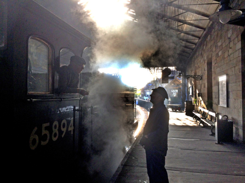 In the steamy atmosphere of Pickering station Driver Terry Newman gives instructions to his J27 fireman  John Steeles  about the planed shunting movements - Maurice Burns