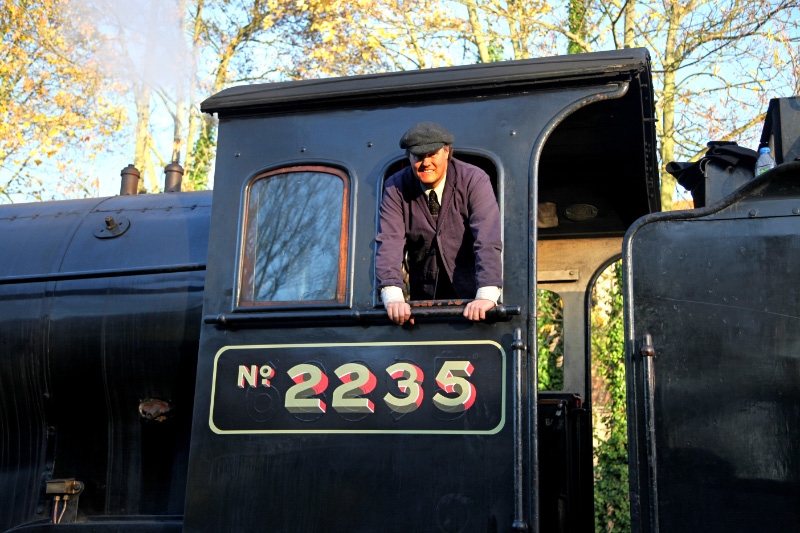Driver Neil Woods who had a major part to play in the filming poses in the cab of Q6 No 2235 - Maurice Burns