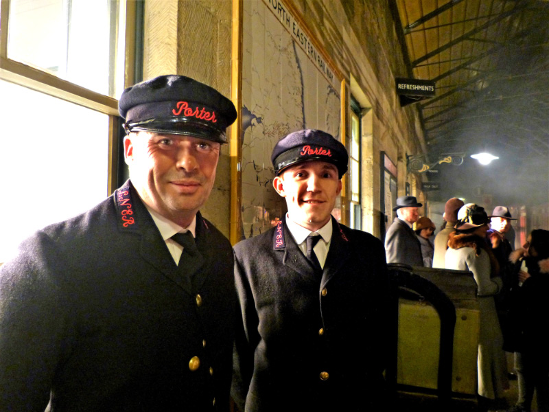 Two film extras look the part after being fitted out as porters in 1927 clothing - Terry Newman
