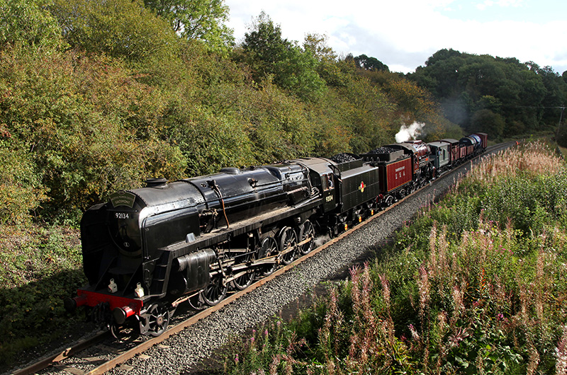 9F No 92134  double heading with the S160 No 2253 speeds downhill towards Esk Valley cottages with a Goathland to Grosmont freight - Maurice Burns