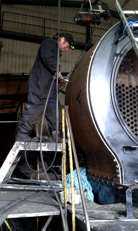 J27 Phil Naylor working on right hand side of smokebox wrapper - Chris Lawson