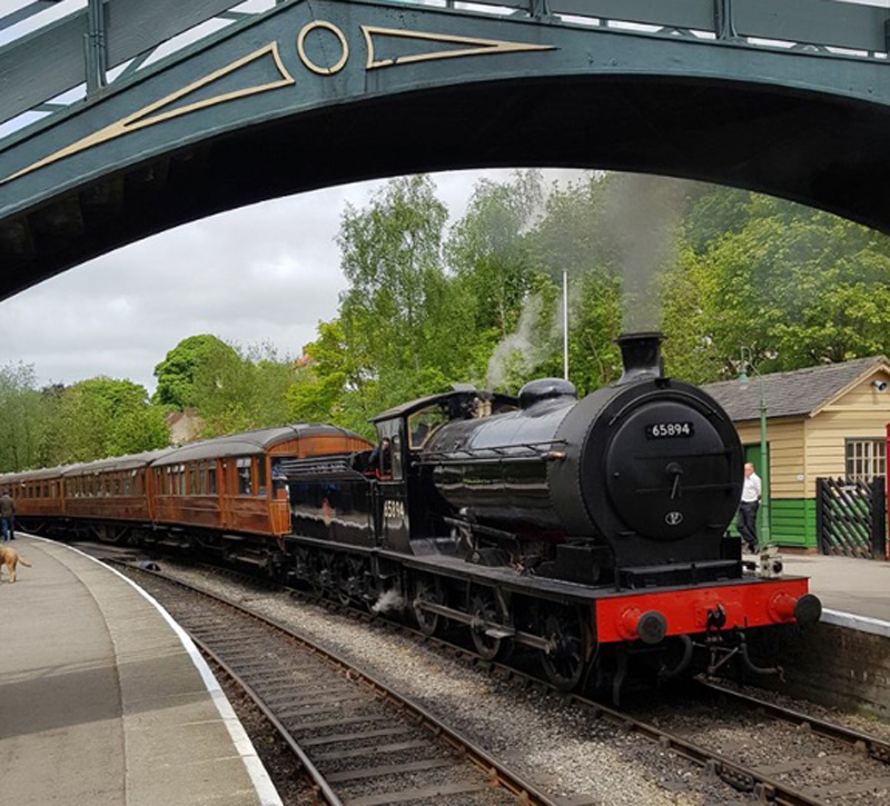 J27 stands at Pickering after its first run from Grosmont with the teak set