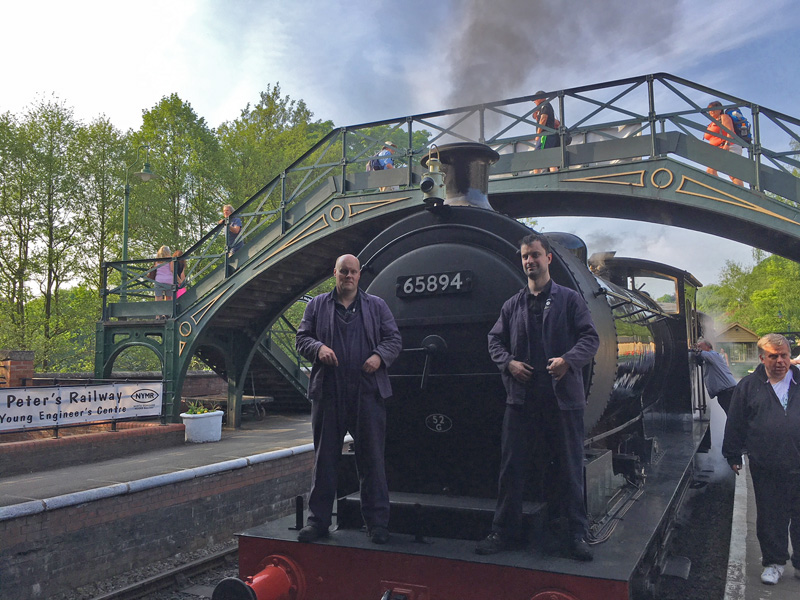 Driver Neal Woods (who oversaw so much of the overhaul) and fireman Richard Worrell pose in front of the smokebox - Terry Neman