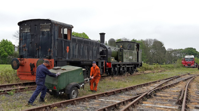 Colin Bowman and Steve Gibson struggle with the compressor used to start the shunter - Nigel Hall