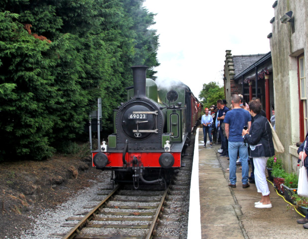 The morning train arrives at  a busy Finghall - Maurice Burns