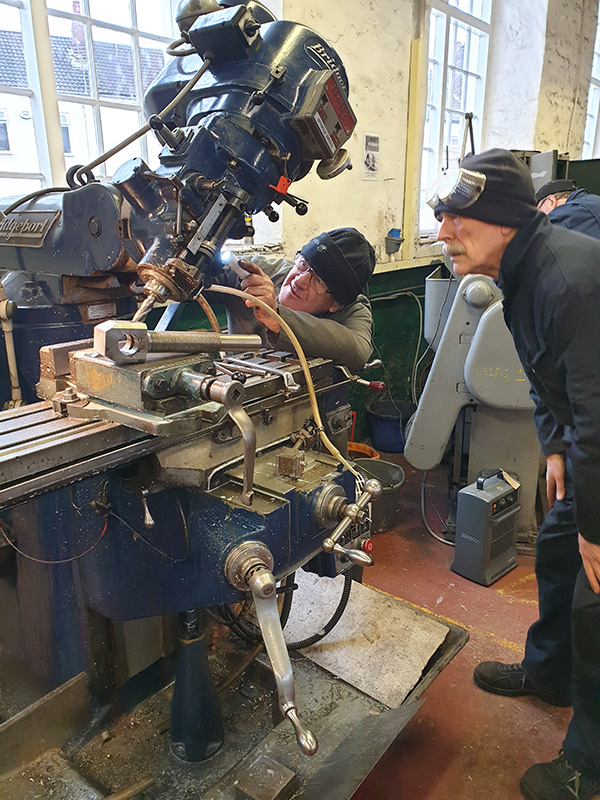Arthur Jenkins and John Jones setting up the Bridgeport miller whilst machining a spring hanger bolt - Nigel Hall