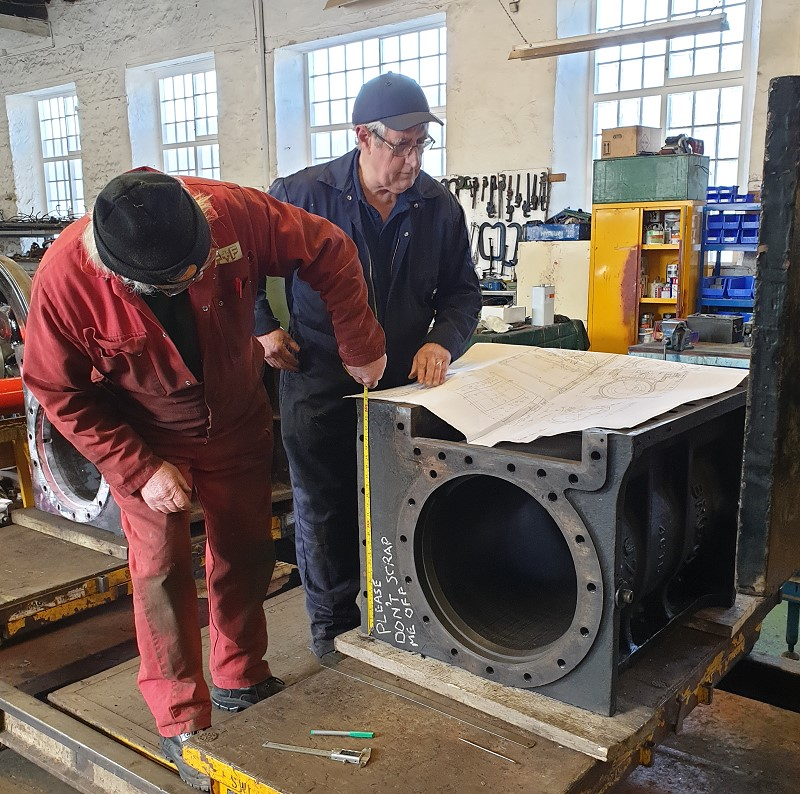 Tim Williamson and Norman Wells checking the cylinder casting dimensions against a drawing – Nigel Hall