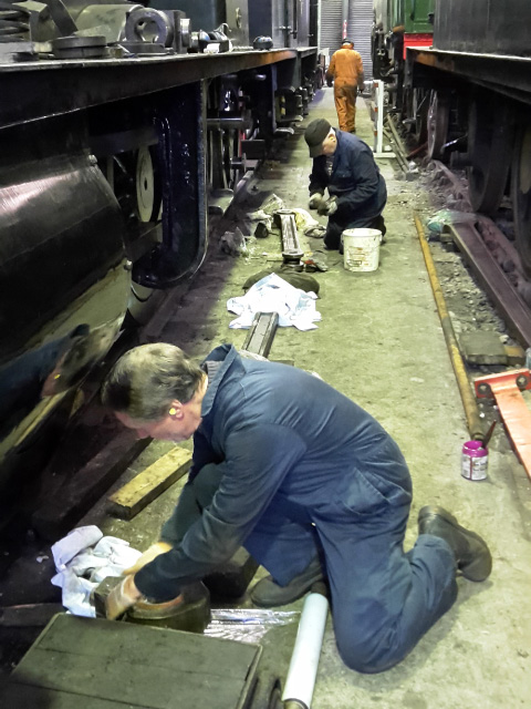 Roy Marshall and Derek Shorton clean and wrap the side rod bearings - Nigel Hall