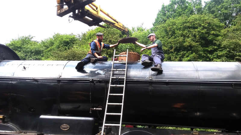 Chris Henwood and Thomas Dibbs fit the Q6 dome cover at Grosmont on 16 June 2018 - Ian Pearson.